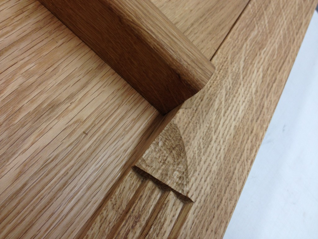 Detail of the mouldings in Oak on the Madrid Screen.