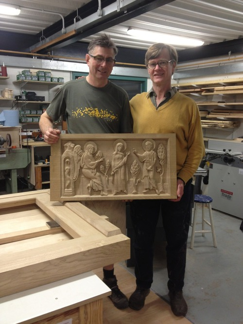 Dylan with Aidan and the carving of the Angel with Mary M as…